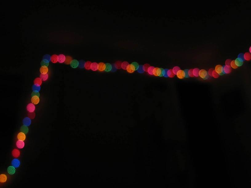 blurry, colorful balls of light in the dark